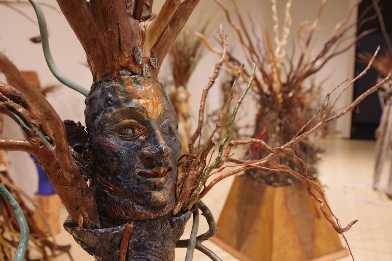 Crown Tree by Sniedze Janson-Runģis. Runģis says humans are supposed to be the crown of civilization — but if we are to become that, we have to be much more benevolent. She found a root that she thought looked a lot like a crown and that was the basis.