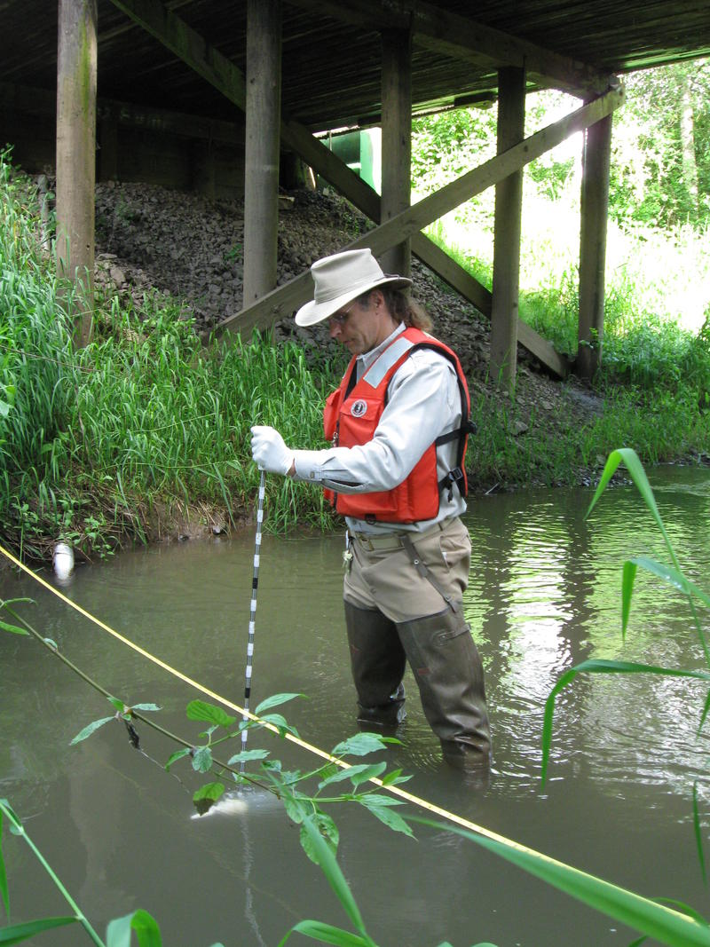 USGS scientist collecting a water-quality sample from Zollner Creek, Oregon for a national-scale investigation of the environmental occurrence of neonicotinoid insecticides in agricultural and urban settings.