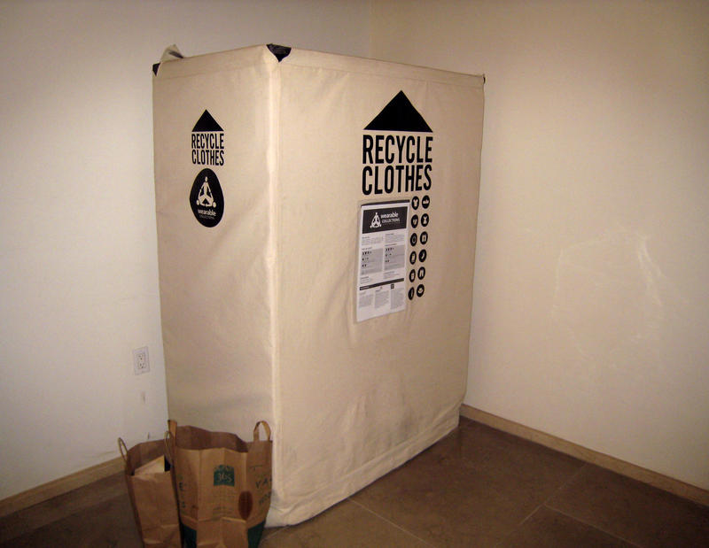 A Wearable Collections clothes recycling bin is seen inside EPIC Residences, Thursday, July 1, 2010, in New York. Wearable Collections is not one of the company's accused of misleading labels.