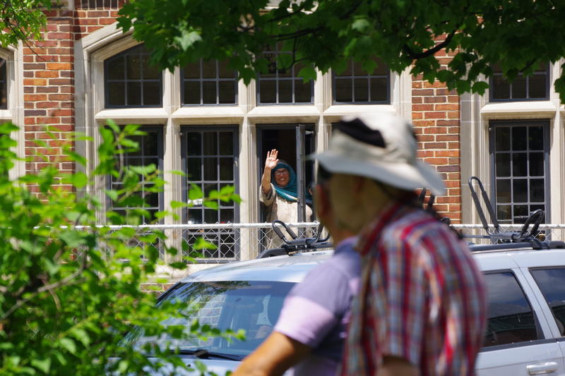 Saheeda Nadeem waved from the window of the First Congregational Church. Nadeem faces a deportation order if she leaves the church.