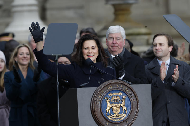 Democratic Michigan Gov. Gretchen Whitmer waves after her speech outside the state Capitol building, Tuesday, Jan. 1, 2019 in Lansing, Mich. (AP Photo/Carlos Osorio)
