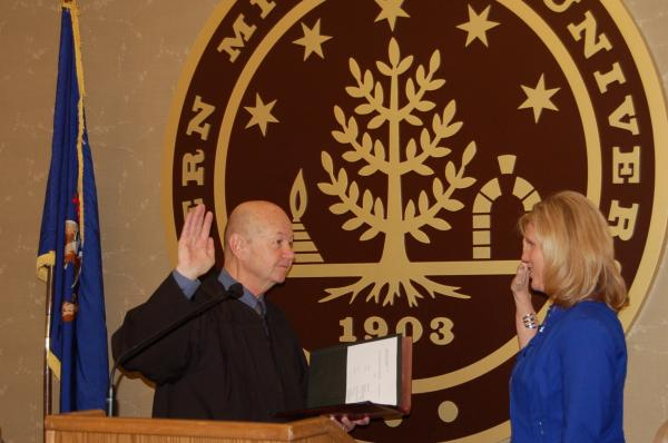 Trustee Michelle Crumm being sworn in.