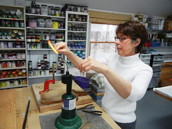 Gloria Badiner at her glass art studio in Mattawan