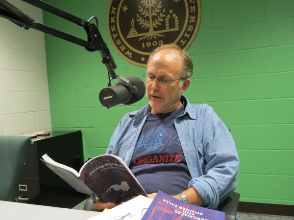 Kalamazoo poet Rob Haight reading from his book 'Feeding Wild Birds' in the WMUK studio.