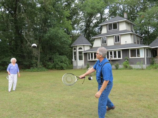Cheryl and Donald Benson playing a net-less version of Eclipse Ball at their home in Newaygo County