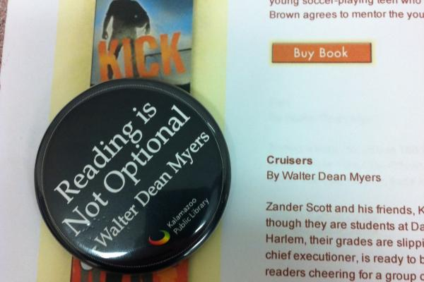 Button used to promote Myers's visit to the Kalamazoo Public Library