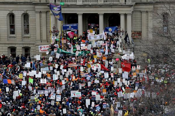 """Protesters rally at the state Capitol in 2012 opposing a """"right to work"""" law for Michigan - file photo"""