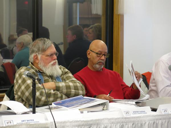 Comstock Township planning commissioners listen during a presentation by Enbridge Energy officials at a meeting Feb. 17.