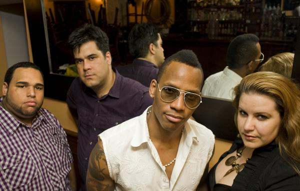 Martinez (center) is the name behind the Pedrito Martinez Group. The group will perform March 13 at Kalamazoo Valley Community College.