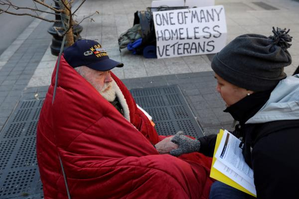 Korean War Veteran speaks with a coordinator for Homeless Street Team Outreach in this November, 2013 file photo