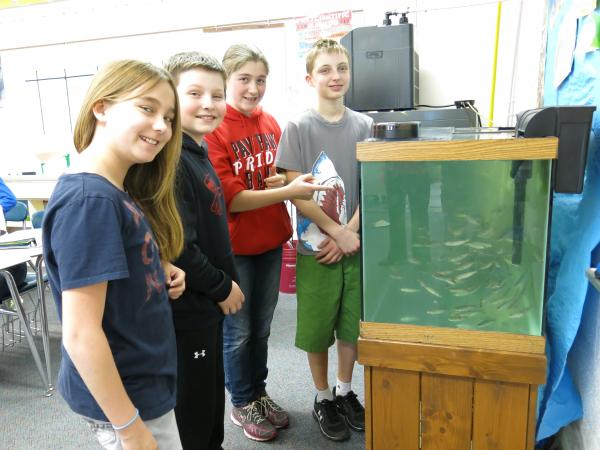 Paw Paw Middle School students and their salmon