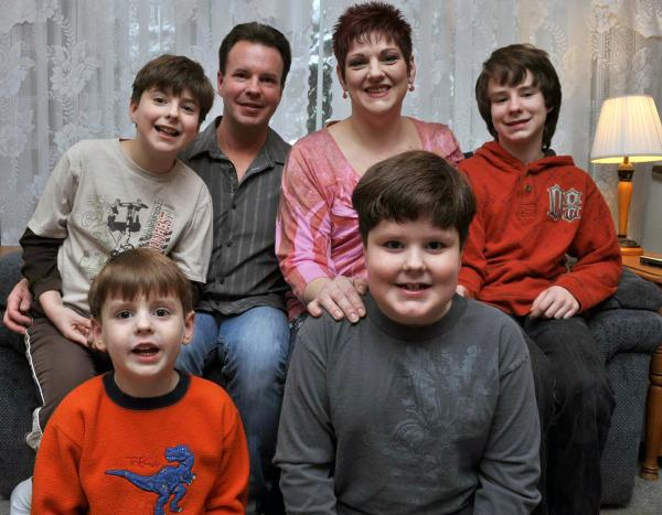 Keith and Kelli Gibson of Battle Creek with their sons who all have forms of autism