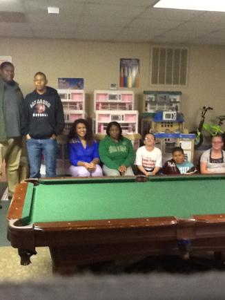 kids beside a pool table