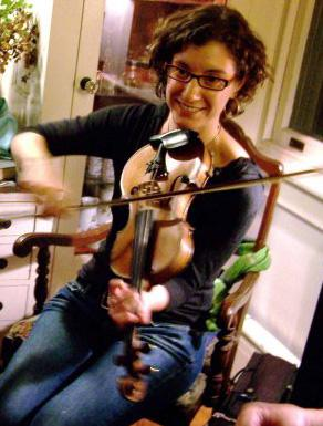 Rayna with a violin