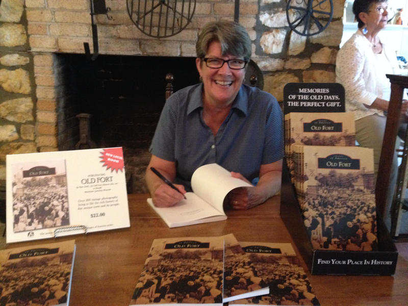 "Kim Clark at book signing for ""The History of Old Fort"""