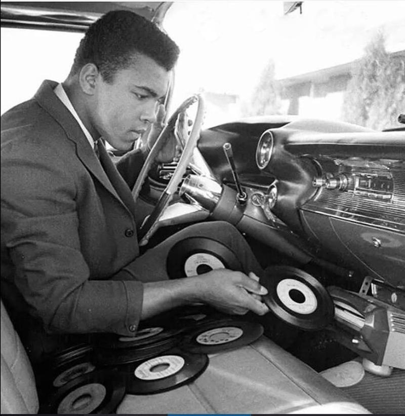 Muhammed Ali with record player in car