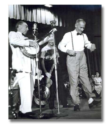 Men performing on stage