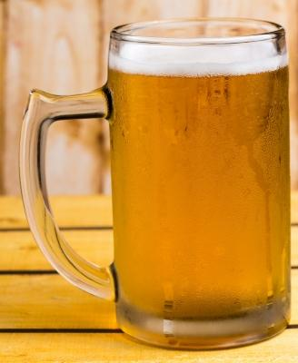Image of orange colored beer in frosty mug