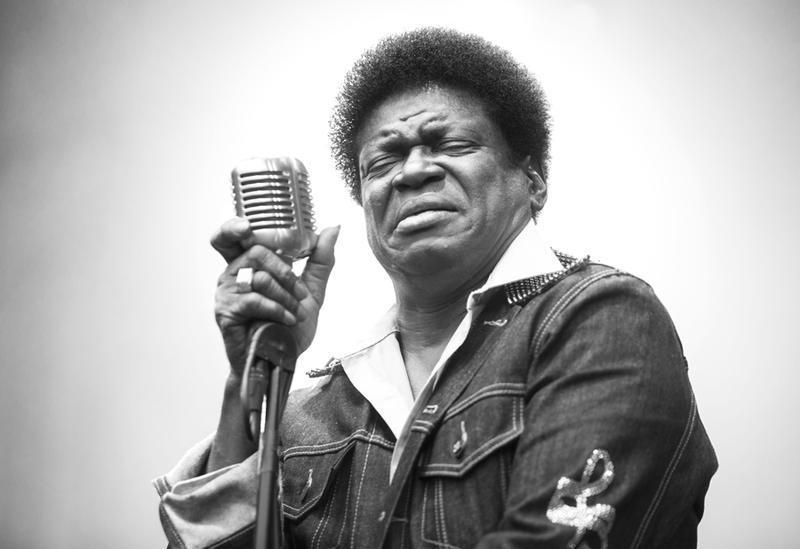 Image of soul singer Charles Bradley Singing into Mic