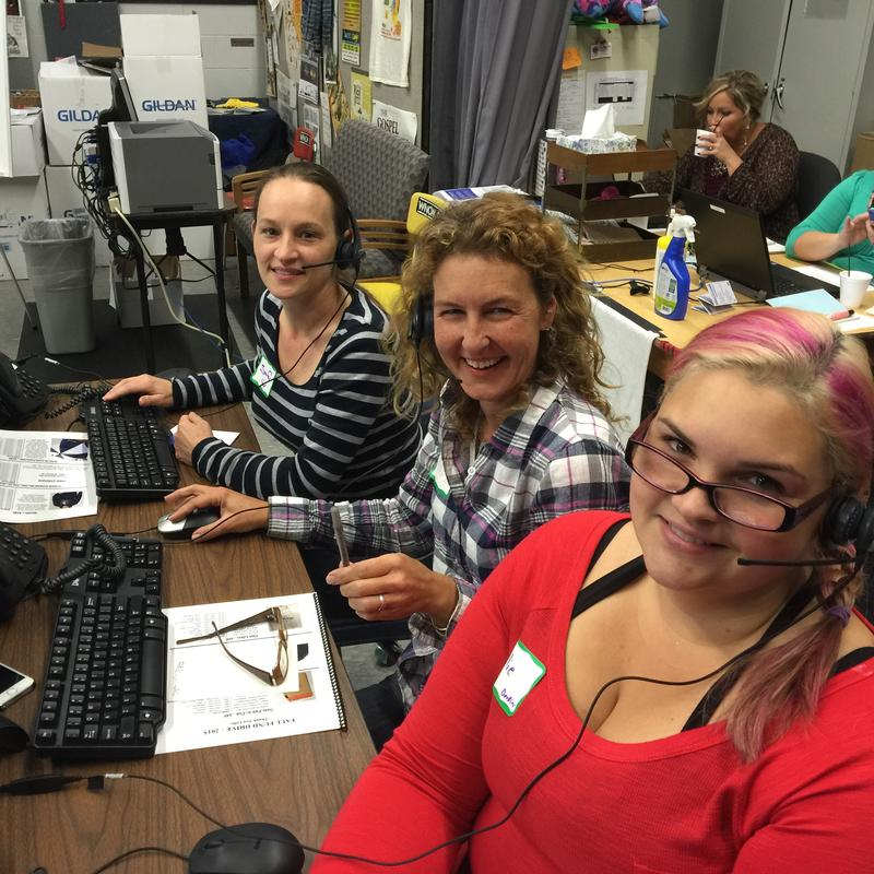 Image of three women answering phones smiling at WNCW fundraiser
