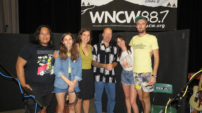 Image of members of the Wild Reeds band with DJ Scotty