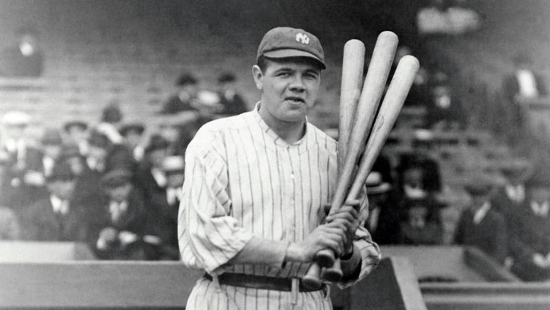 Babe Ruth holding bats