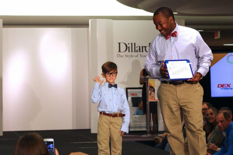 Davis dreams to be a teacher one day, walking with College Math Professor Patrick Torrence