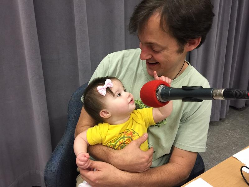 image of baby with man near microphone