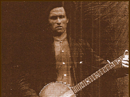 Old image of a man holding a banjo