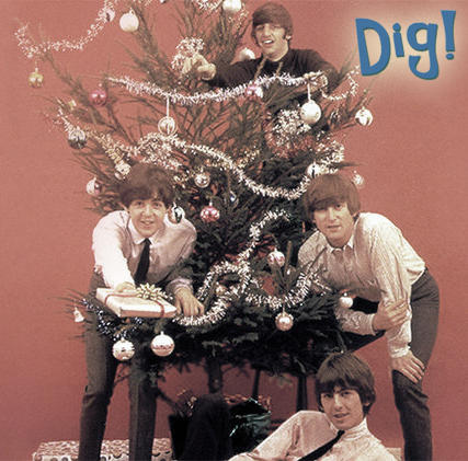 Image of musicians known as the Beatles hanging around a Christmas Tree