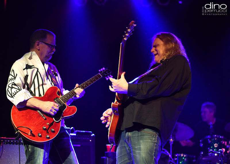 Warren Haynes performing on stage with special guest at a Pre-Jam event.