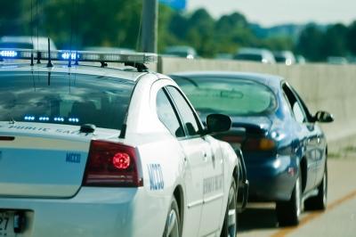 Image of police car pulling over regular car
