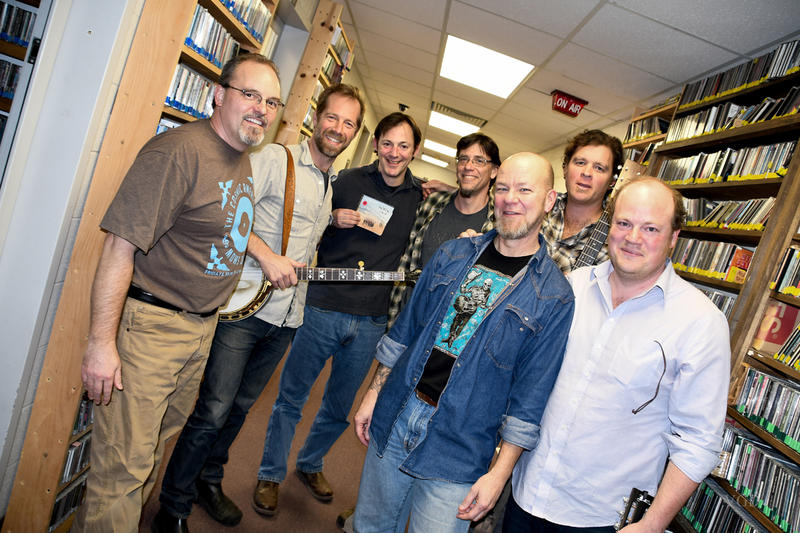 Joe Kendrick, Graham Sharp, Martin Anderson, Roland Dierauf, Scotty Roberton, Woody Platt, and Mike Ashworth in the hallway of WNCW after an on air visit.