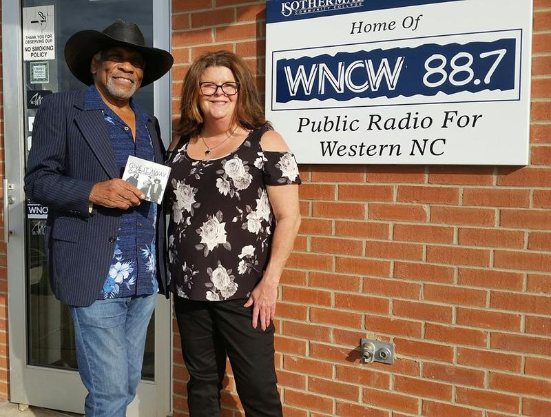 Mac Arnold and Renee Denton standing outside WNCW's Studio.