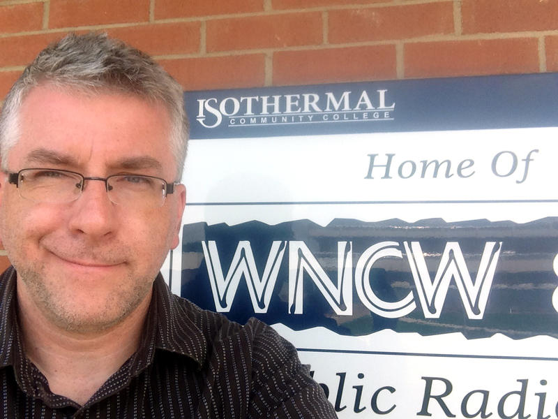 Paul Foster in front of WNCW sign.