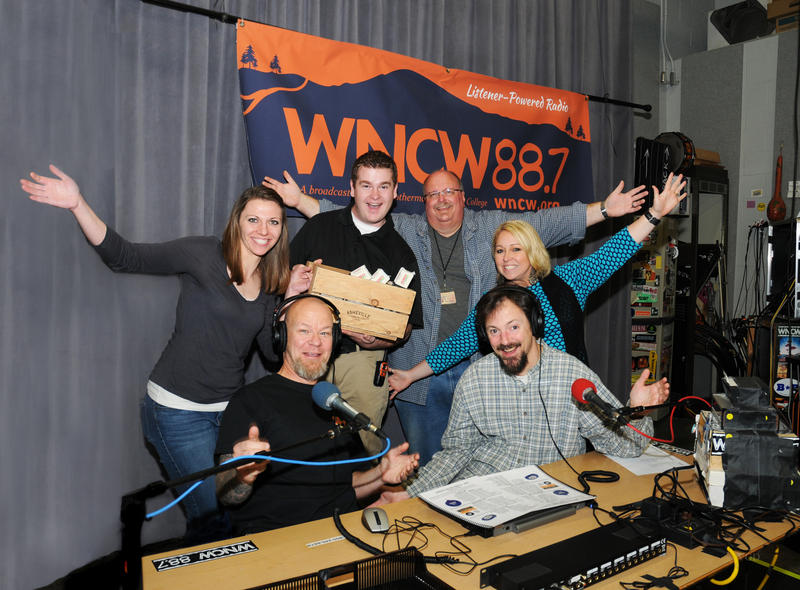 Image of happy people in radio station studio smiling and waving hands