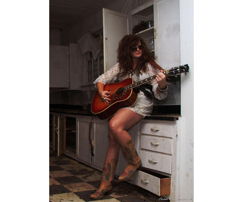 Lily Tallent holding guitar