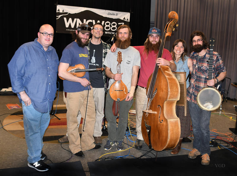 Image of Pretty Little Goat Band smiling and holding instruments in WNCW's Studio B