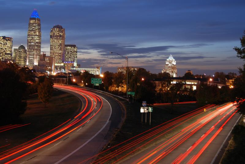 car light trails with Charlotte, NC Skyline in background
