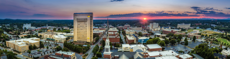 city of spartanburg with sunset