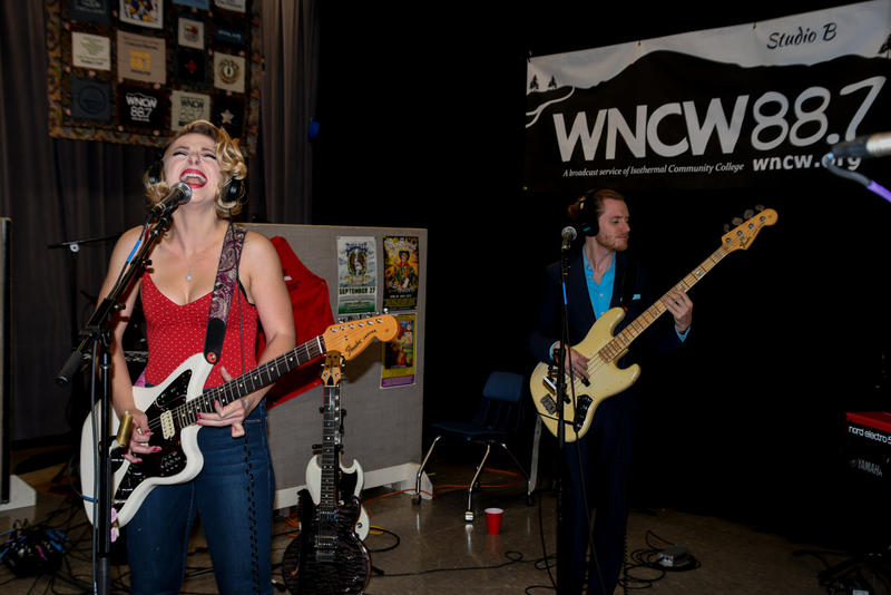 image of female and male singer rocking it with guitar and bass instruments
