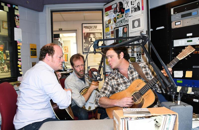 band members singing in studio