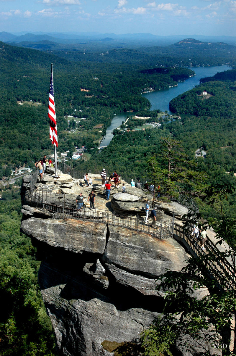 Image of the giant rock known as Chimney Rock. Lake Lure is in the background