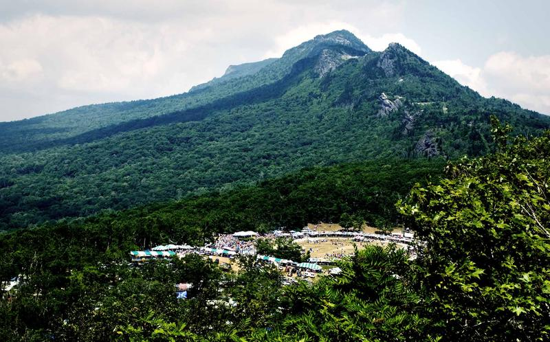 image of large mountain with games and festival in valley