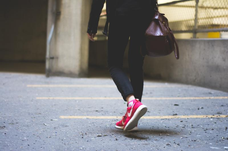 Woman walking on pavement