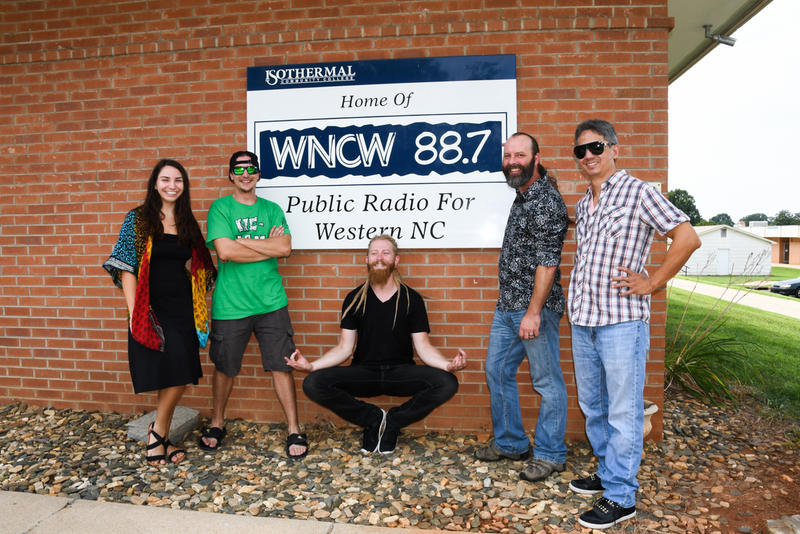 image of band members hanging out in front of wncw sihn