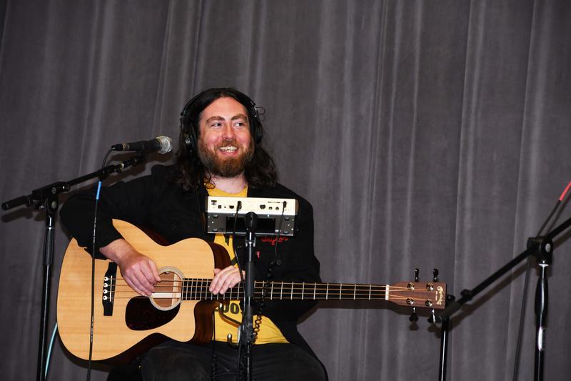 Guitarist smiling