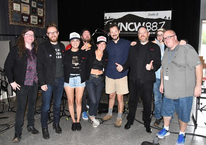Band posing with WNCW staff