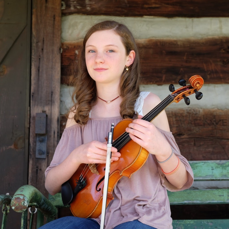 Image of young female musician holding fiddle