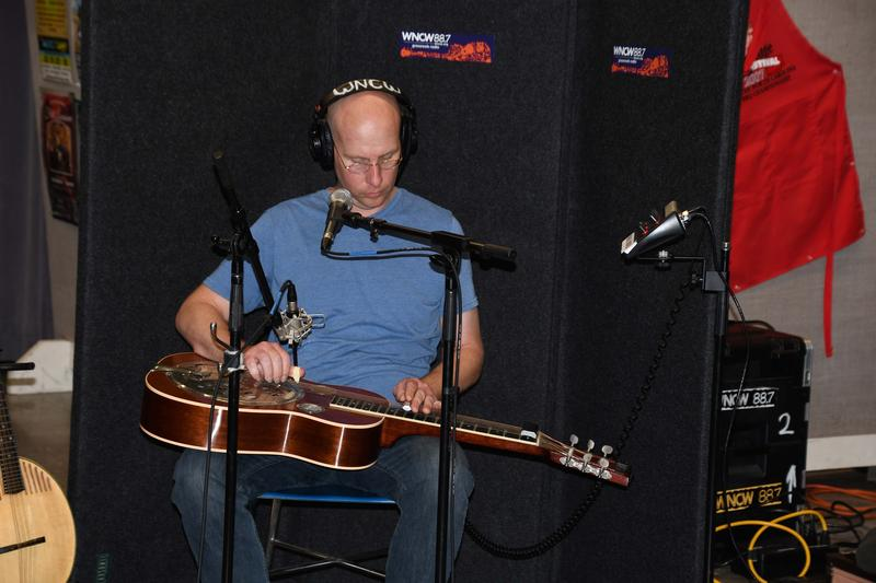 Man playing dobro in Studio B